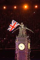 12 AUG 2012 - LONDON, GBR - A performer waves the Union flag from the top of a model of the Elizabeth Tower during the Street Party section of the London 2012 Olympic Games Closing Ceremony in the Olympic Stadium in the Olympic Park, Stratford, London, Great Britain .(PHOTO (C) 2012 NIGEL FARROW)