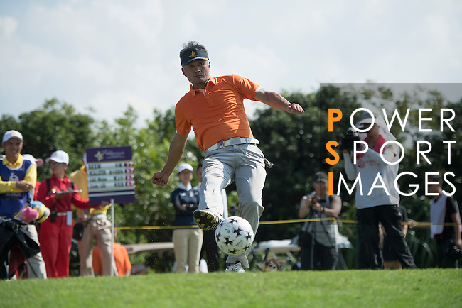 Cao Weiyu kicks a football at the 14th hole during the World Celebrity Pro-Am 2016 Mission Hills China Golf Tournament on 22 October 2016, in Haikou, China. Photo by Weixiang Lim / Power Sport Images