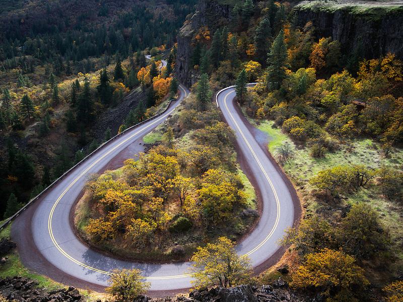 Curving road (Columbia River Gorge historic road) with fall colors. Columbia River Gorge National Scenic Area, Oregon