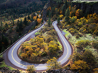 Curving road (Columbia River Gorge historic road) with fall colors. Columbia River Gorge National Scenic Area, Oregon