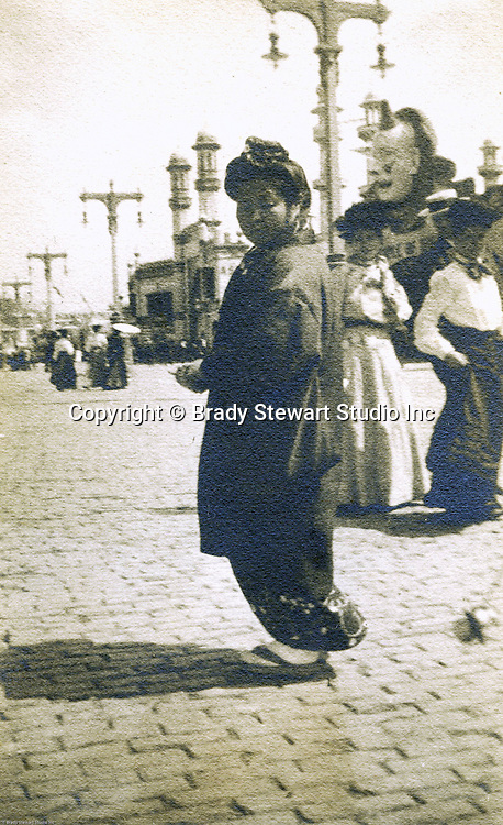 St Louis Mo:  View of a Japanese woman walking down the pike in full Japanese dress.