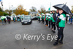 Killarney Legion players and supporters give a guard of honour for former player Derek Twomey as his coffin arrives to Dirren  on Monday