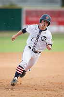 Daniel Millwee (7) of the High Point-Thomasville HiToms hustles towards third base against the Asheboro Copperheads at Finch Field on June 12, 2015 in Thomasville, North Carolina.  The HiToms defeated the Copperheads 12-3. (Brian Westerholt/Four Seam Images)