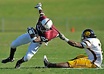 A&M's wide receiver Rashad Johnson gets snagged by Grambling's defensive back Lance Castleberry.  Alabama A&M vs. Grambling State football at Louis Crews Stadium Saturday afternoon for Homecoming.     Bob Gathany / The Huntsville TImes
