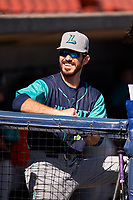 Lynchburg Hillcats bench coach Grant Fink (33) in the dugout before the first game of a doubleheader against the Frederick Keys on June 12, 2018 at Nymeo Field at Harry Grove Stadium in Frederick, Maryland.  Frederick defeated Lynchburg 2-1.  (Mike Janes/Four Seam Images)