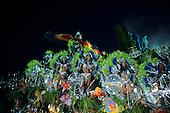 Rio de Janeiro, Brazil. Carnival; girls dancing on a float with rainforest, macaws, satellite dishes; Portela samba school.