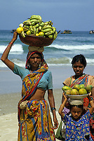 Portrait of two women and a little girl selling fruit on Colva Beach, Goa, India, 1985.