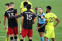 NASHVILLE, TN - SEPTEMBER 23: Referee Tori Penso issues warnings to Derrick Jones #21 of Nashville SC and Steven Birnbaum #15 of DC United during a game between D.C. United and Nashville SC at Nissan Stadium on September 23, 2020 in Nashville, Tennessee.
