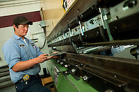 A worker at Max Daetwyler Corporation, which manufactures equipment and products for the printing industry, including pressroom applications in the gravure and flexographic industry. The founders of Daetwyler USA started the company in 1975. Located in Huntersville, NC, the manufacturing company employs more than 70 people.