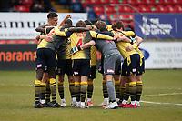 Woking players huddle during Dagenham & Redbridge vs Woking, Vanarama National League Football at the Chigwell Construction Stadium on 3rd May 2021
