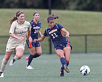 Pepperdine University forward Callie Payetta (11) clears the ball as Boston College midfielder Alicia Blose (13) closes. Pepperdine University defeated Boston College,1-0, at Soldiers Field Soccer Stadium, on September 29, 2012.
