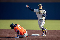 Michigan Wolverines second baseman Riley Bertram (12) turns a double play during the NCAA baseball game against the Illinois Fighting Illini at Fisher Stadium on March 19, 2021 in Ann Arbor, Michigan. Illinois won the game 7-4. (Andrew Woolley/Four Seam Images)