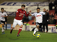 Pictured: Wayne Routledge of Swansea (R) challenged by Scott Wiseman of Barnsley (L). Saturday 07 January 2012<br /> Re: FA Cup football Barnsley FC v Swansea City FC at the Oakwell Stadium, south Yorkshire.
