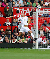 Pictured L-R: Battling for a header, Javier Hernandez of Manchester United against Jonjo Shelvey of Swansea. Saturday 16 August 2014<br />