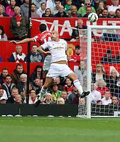 Pictured L-R: Battling for a header, Javier Hernandez of Manchester United against Jonjo Shelvey of Swansea. Saturday 16 August 2014<br /> Re: Premier League Manchester United v Swansea City FC at the Old Trafford, Manchester, UK.