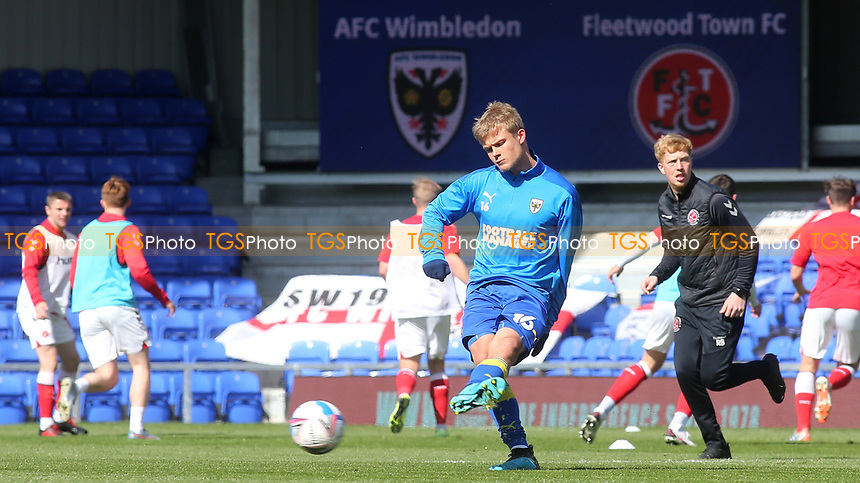 Jaakko Oksanen of AFC Wimbledon warms up ahead of kick-off during AFC Wimbledon vs Fleetwood Town, Sky Bet EFL League 1 Football at Plough Lane on 5th April 2021