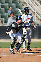 Kannapolis Intimidators catcher Casey Schroeder (10) checks the runner at third base as Gerrion Grim (18) of the Delmarva Shorebirds steps out of the batters box at Kannapolis Intimidators Stadium on April 13, 2016 in Kannapolis, North Carolina.  The Intimidators defeated the Shorebirds 8-7.  (Brian Westerholt/Four Seam Images)