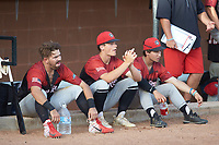 (L-R) Alex Morales (11) (Greensboro College), Joe Carawan (21) (Wake Technical Community College), and James Rice (1) (Mount Aloysius College) of the Deep River Muddogs watch the game against the High Point-Thomasville HiToms from the top step of the dugout at Finch Field on June 27, 2020 in Thomasville, NC.  The HiToms defeated the Muddogs 11-2. (Brian Westerholt/Four Seam Images)