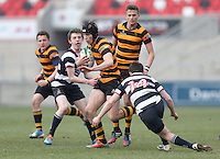 2015 ULSTER SCHOOLS CUP FINAL | Tuesday 17th March 2015<br /> <br /> Jack Conlin is tackled by Connor Guiney during the 2015 Ulster Schools Cup Final between RBAI and Wallace High School at the Kingspan Stadium, Ravenhill Park, Belfast, Count Down, Northern Ireland.<br /> <br /> Picture credit: John Dickson / DICKSONDIGITAL