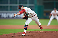 Houston Cougars starting pitcher Trey Cumbie (15) follows through on his delivery against the Kentucky Wildcats in game two of the 2018 Shriners Hospitals for Children College Classic at Minute Maid Park on March 2, 2018 in Houston, Texas.  The Wildcats defeated the Cougars 14-2 in 7 innings.   (Brian Westerholt/Four Seam Images)