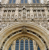 A row of noble, carved monarchs stands in niches along one side of Victoria Tower, while cheeky gargoyles grimace out from the carved stone work around them