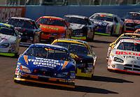 Nov 12, 2005; Phoenix, Ariz, USA;  Nascar driver Carl Edwards leads the field on the first lap of the Busch Series Arizona 200 at Phoenix International Raceway. Mandatory Credit: Photo By Mark J. Rebilas