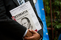 "Palermo (Sicily - Italy), 19/07/2017. ""Basta depistaggi e omertà di Stato!"" (""Stop disinformation & omertá by the State!"")(1). Public event to commemorate the 25th Anniversary of the assassination of the anti-mafia Magistrate Paolo Borsellino along with five of his police ""scorta"" (Escorts from the special branch of the Italian police force who protect Judges): Agostino Catalano, Emanuela Loi (The first Italian female member of the police special branch and the first woman of this branch to be killed on duty), Vincenzo Li Muli, Walter Eddie Cosina and Claudio Traina. The event was held at Via D'Amelio, the road where Borsellino was killed. Family members of mafia victims, amongst others, made speeches about their dramatic experiences, mafia violence and unpunished crimes, State cover-ups, silence ('omertá'), and misinformation. Speakers included, amongst others, Vincenzo Agostino & Augusta Schiera, Salvatore & Cristina Catalano, Graziella Accetta, Massimo Sole, Paola Caccia, Luciano Traina, Angela Manca, Stefano Mormile, Ferdinando Imposimato, Judge Nino Di Matteo. The event ended with the screening of the RAI docu-fiction, 'Adesso Tocca A Me' ('Now it's My Turn' - Watch it here: http://bit.ly/2w3WJUX ).<br />
