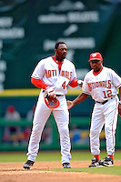 4 September 2005: Preston Wilson, outfielder for the Washington Nationals,gets a pat from first base coach Don Buford during a game against the Philadelphia Phillies. Wilson went 3 for 4, with a 3-run homer in the 7th inning, as the Nationals defeated the Phillies 6-1 at RFK Stadium in Washington, DC. Mandatory Photo Credit: Ed Wolfstein.