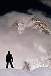 Mountain climber views K2, Karakorum range, Pakistan