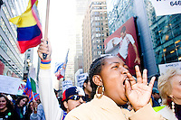 Hawa Kamara, originally from Liberia, shouts in unison with other demonstrators at the end of a march and rally for immigrant rights at Times Square in New York City on October 21, 2006.