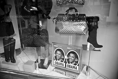 Manhattan, New York.<br /> USA<br /> Oct 2008<br /> <br /> Shoe on sale in a window display with photo of Democratic presidential candidate U.S. Sen. Barack Obama