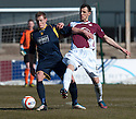 Albion's Christopher Dallas and Arbroath's Alex Keddie challenge for the ball.