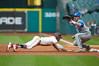 Grayson Padgett (18) of the Houston Cougars dives back towards first base as Kole Cottam (13) of the Kentucky Wildcats waits for a pick-off throw in game two of the 2018 Shriners Hospitals for Children College Classic at Minute Maid Park on March 2, 2018 in Houston, Texas.  The Wildcats defeated the Cougars 14-2 in 7 innings.   (Brian Westerholt/Four Seam Images)
