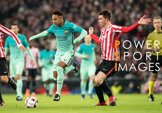 Neymar da Silva Santos Junior (c) of FC Barcelona battles for the ball with Aymeric Laporte (r) and Ander Iturraspe Derteano of Athletic Club during their Copa del Rey Round of 16 first leg match between Athletic Club and FC Barcelona at San Mames Stadium on 05 January 2017 in Bilbao, Spain. Photo by Victor Fraile / Power Sport Images