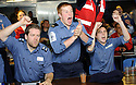 ENGLAND FANS CELEBRATE A TRY AS THEY WATCH THE RUGBY WORLD CUP QUARTER FINAL BETWEEN FRANCE AND ENGLAND ON THE HMS BULWARK WHILST ON A BREAK FROM A JOINT EXERCISE IN LOCH EWE AND OFF THE SCOTTISH ATLANTIC COAST