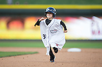 A young Winston-Salem Dash fan competes in a between innings contest during the game against the Lynchburg Hillcats at BB&T Ballpark on April 28, 2016 in Winston-Salem, North Carolina.  The Dash defeated the Hillcats 4-1.  (Brian Westerholt/Four Seam Images)