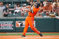 Oklahoma State Cowboys catcher Gage Green #17 swings the bat during the NCAA baseball game against the Texas Longhorns on April 26, 2014 at UFCU Disch–Falk Field in Austin, Texas. The Cowboys defeated the Longhorns 2-1. (Andrew Woolley/Four Seam Images)