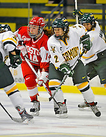9 February 2008: Boston University Terriers' forward Caroline Bourdeau (left), a Junior from West Hartford, CT, battles University of Vermont Catamounts' forward Molly Morrison, a Freshman from So. Burlington, VT, at Gutterson Fieldhouse in Burlington, Vermont. The Terriers shut out the Catamounts 2-0 in the Hockey East matchup...Mandatory Photo Credit: Ed Wolfstein Photo