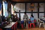 Locals enjoying food at a local resturant and bar in Central Bhutan. Arindam Mukherjee..