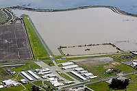 aerial photograph of a levy holding back flooding at the Sonoma Valley Airport, also known as Shellville airport (0Q3), Sonoma County, CA