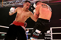 19th December 2020, Hamburg, Germany; Universal Boxing Promotion fight, Felix Sturm versus Timo Rost; Rost with an left uppercut