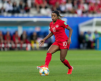 GRENOBLE, FRANCE - JUNE 15: Ashley Lawrence #10 of the Canadian National Team passes the ball during a game between New Zealand and Canada at Stade des Alpes on June 15, 2019 in Grenoble, France.