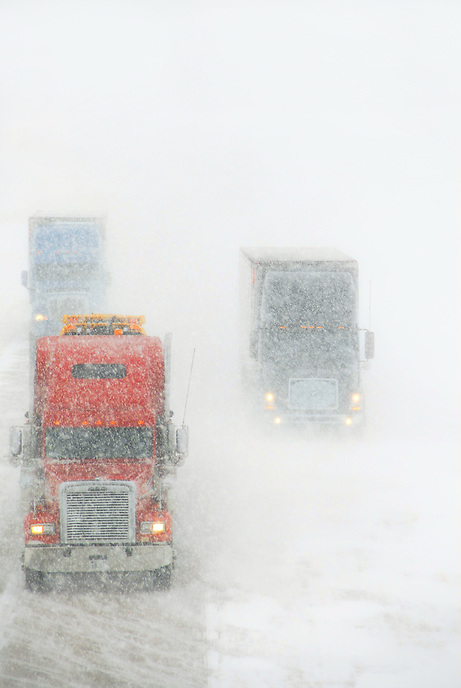 Semi-trucks slowly crawl along Interstate 35 in northern Oklahoma during a late November blizzard.
