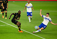 LOS ANGELES, CA - SEPTEMBER 02: Bradley Wright-Phillips #66 of LAFC takes a shot on Tanner Beason #15 of the San Jose Earthquakes during a game between San Jose Earthquakes and Los Angeles FC at Banc of California stadium on September 02, 2020 in Los Angeles, California.