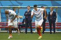 Netherlands manager Louis van Gaal watches Robin van Persie and Nigel de Jong warm up