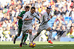 Cristiano Ronaldo of Real Madrid is followed by Alberto Martin of Deportivo Leganes during their La Liga match between Real Madrid and Deportivo Leganes at the Estadio Santiago Bernabéu on 06 November 2016 in Madrid, Spain. Photo by Diego Gonzalez Souto / Power Sport Images