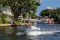 Ft. Lauderdale, Florida.  Pleasure Boating on New River.  Carrie B Sightseeing Paddle-wheel in the background.