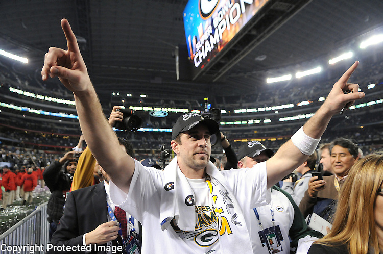 Green Bay Packers quarterback Aaron Rodgers raises his arms as he leaves the field after the Packers defeated the Pittsburgh Steelers during the Super Bowl XLV at Cowboys Stadium in Arlington, Texas on Feb. 6, 2011.