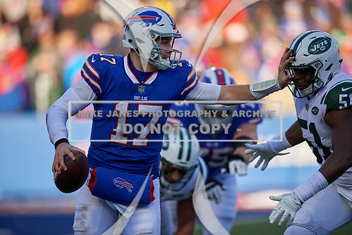 Buffalo Bills quarterback Josh Allen (17) stiff arms Brandon Copeland (51) while scrambling during an NFL football game against the New York Jets, Sunday, December 9, 2018, in Orchard Park, N.Y.  (Mike Janes Photography)