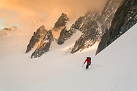 Tom Livingstone skis down the Valle Blanche at sunrise, Chamonix, Alps, Mont Blanc Massif, France
